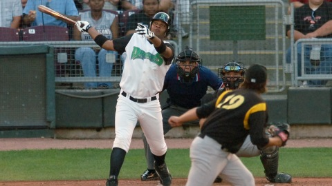 Juan Fancisco hits one of the Dragons 6 home runs in the second inning.